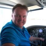 Randy Green in cockpit of twin